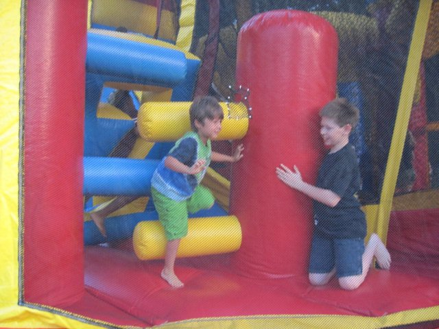 Two boys enjoy a bounce house