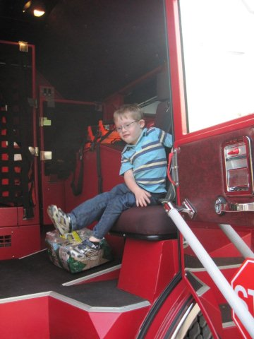 A Boy Enjoys the New Fire Truck