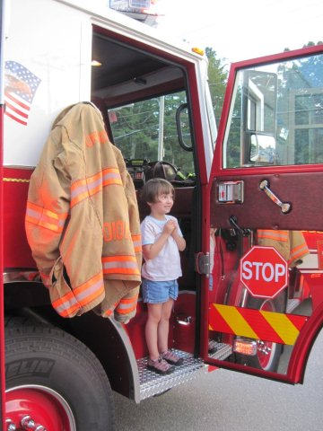 A Girl Enjoys the New Fire Truck